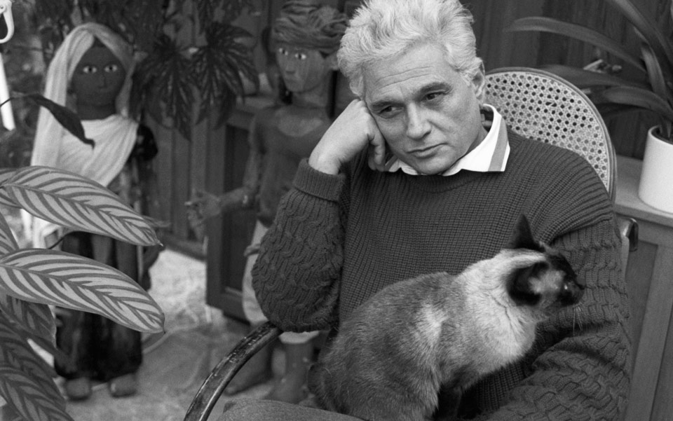 Jacques Derrida and his cat, Logos. Photo by Sophie Bassouls/Sygma/Corbis