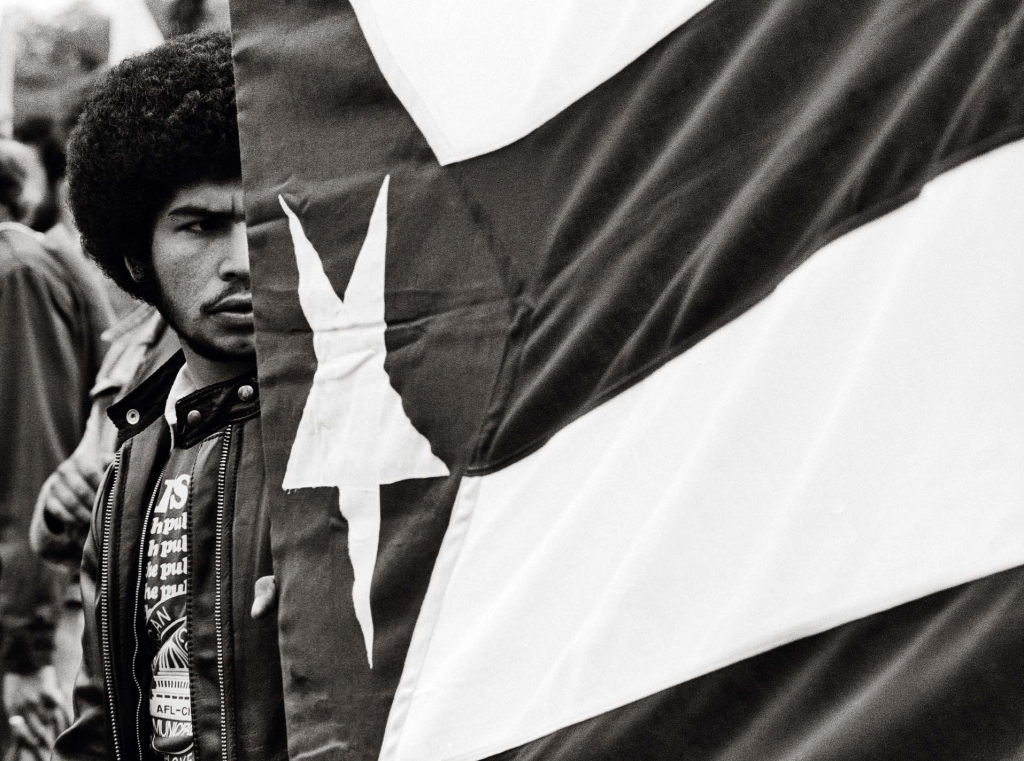 Frank Espada: Man with Flag, Washington DC 1981